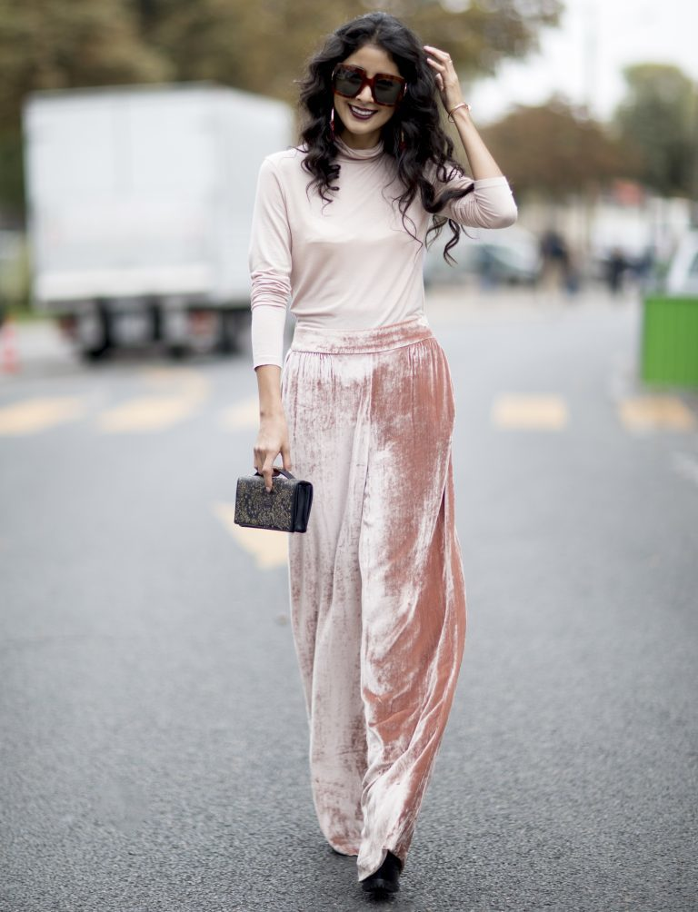 Girl wearing a pink top and pink velvet skirt