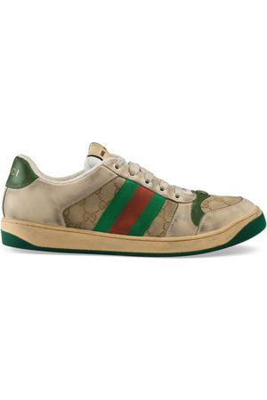 Gucci Sneaker in pelle e tessuto GG consumato