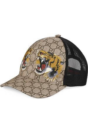 Gucci Cappellino da baseball GG Supreme con stampa tigre . df9c344a61fe