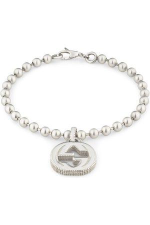 Gucci Bracciale con ciondolo GG in argento