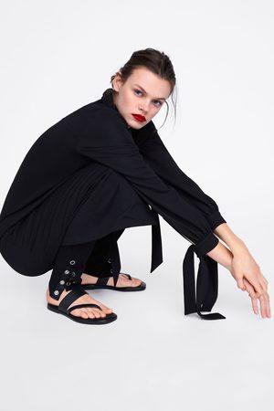 Zara Leggings con bottoni automatici