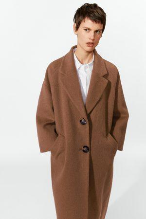 Zara Woman Cappotto in eco pelliccia cognac
