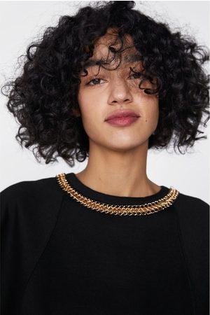 Zara Felpa con catena sul collo