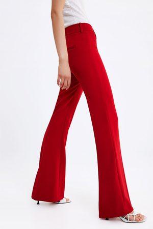venduto in tutto il mondo migliore online a piedi scatti di Pantaloni campana Pantaloni Donne, compara i prezzi e acqusita online