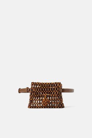 Zara Marsupio con palline in legno