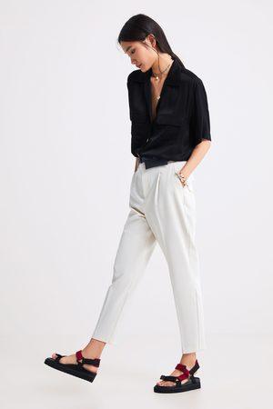 Zara Pantaloni con pince e marsupio