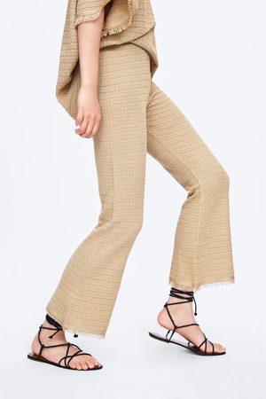 Zara Pantaloni in maglia frange
