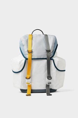 Zara White backpack with multiple pockets