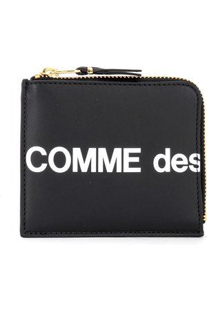 Comme des Garçons Portafoglio Huge Logo chiusura a L in pelle nera