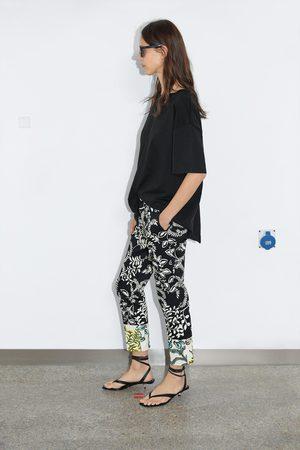Zara Pantaloni chino stampati