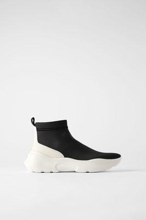 Sneakers a stivaletto modello calzino in tessuto tecnico