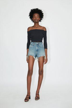 Zara Shorts denim hi-rise con strappi
