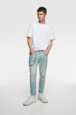 Jeans slim fit catene