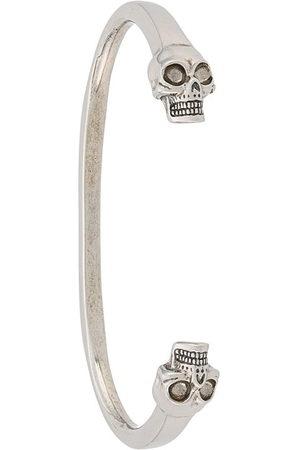 Alexander McQueen Bracciale rigido con teschi - Effetto metallizzato