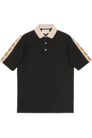 Gucci Polo con nastro GG