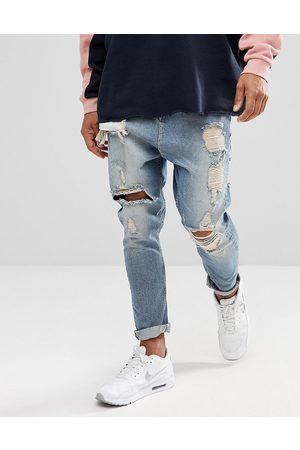ASOS Jeans lavaggio vintage azzurro con cavallo basso e strappi evidenti