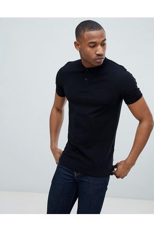 Jack & Jones Essentials - Polo slim nera in piqué con logo