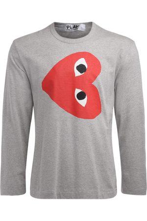 Comme des Garçons T-Shirt manica lunga in cotone con cuore rovescio