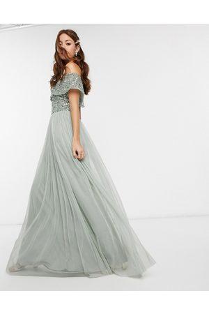 Maya Vestito lungo da damigella in tulle salvia con scollo alla Bardot e delicate paillettes tono su tono