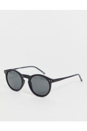 ASOS DESIGN Occhiali da sole rotondi in plastica neri con lenti sfumate