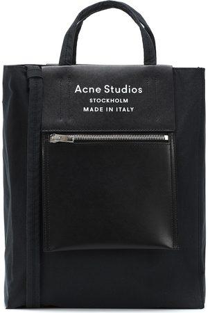 Acne Studios Borsa Baker Out M in tessuto e pelle