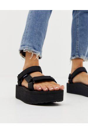 Teva Universal - Sandali flatform neri con suola spessa