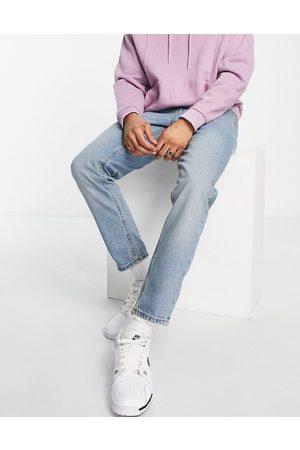 ASOS Jeans affusolati in tonalità polvere