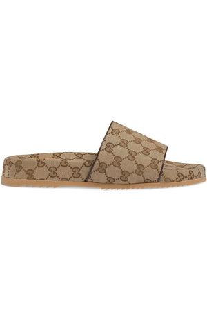 Gucci Slides in GG Supreme - Toni neutri