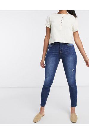 Bershka Jeans skinny bottom-up con fondo grezzo scuro