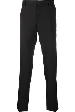 VALENTINO Pantaloni sartoriali con stampa