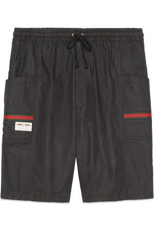 Gucci Uomo Pantaloncini - Shorts in cotone rivestito con etichetta