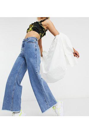 COLLUSION X008 - Jeans con fondo ampio stone wash