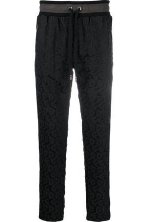 Dolce & Gabbana Pantaloni sportivi con stampa
