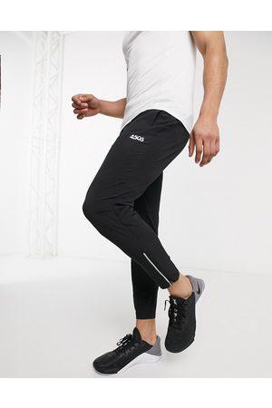 ASOS Joggers da running skinny affusoalti neri con icona e zip riflettente