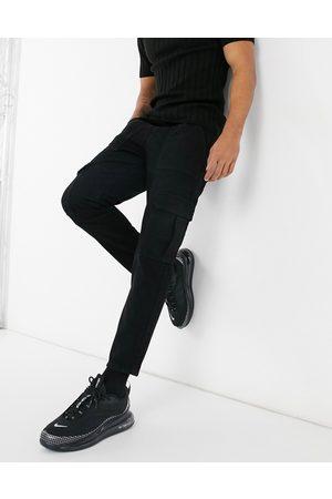 ASOS Jeans rigidi classici neri con tasche cargo