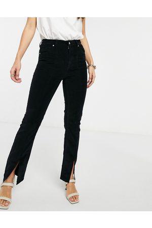 ASOS Sassy - Jeans a vita alta a sigaretta con spacco davanti neri a coste