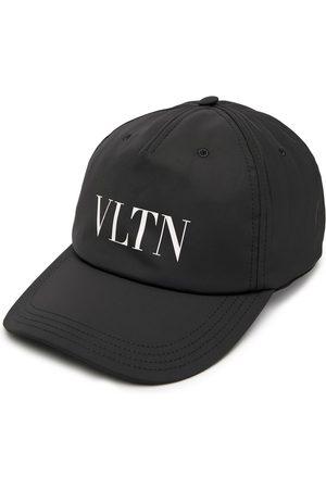 VALENTINO GARAVANI Cappello con stampa VLTN