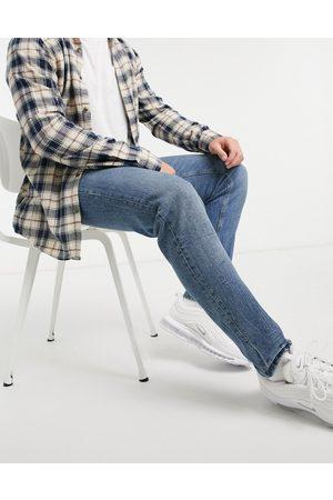 ASOS Jeans affusolati elasticizzati stile vintage lavaggio medio