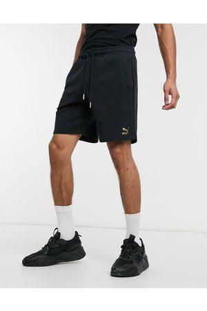 PUMA TFS Unity - Pantaloncini neri con logo metallizzato