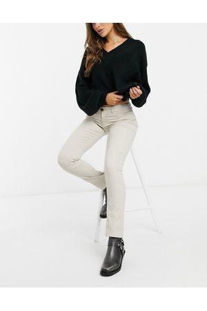 JDY Era - Pantaloni skinny a vita alta in velluto a coste color crema