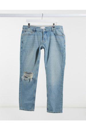 ASOS Jeans slim a vita bassa lavaggio medio vintage stile anni '90 con strappi sul ginocchio