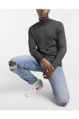 ASOS Jeans affusolati elasticizzati lavaggio chiaro con strappi sulle ginocchia