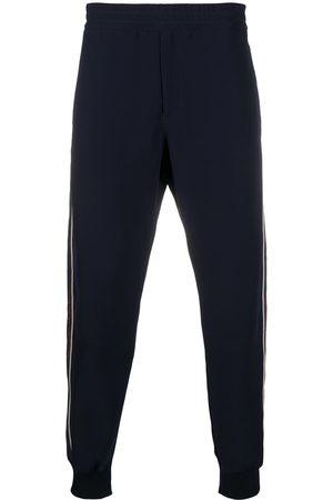 Alexander McQueen Pantaloni sportivi con banda logo