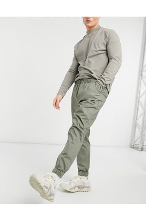 ASOS Joggers chino affusolati con vita elasticizzata kaki