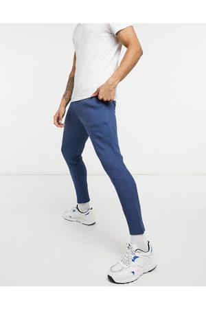 ASOS Uomo Chinos - Joggers super skinny eleganti in tessuto piqué con fondo fisso in coordinato