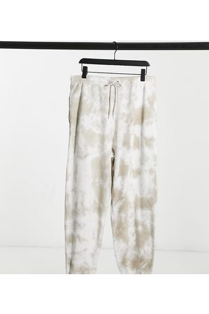 COLLUSION Unisex - Joggers oversize tie-dye