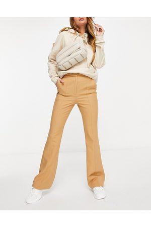 ASOS Pantaloni slim a zampa color cammello con cuciture