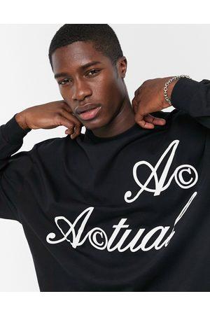 ASOS Actual T-shirt oversize a maniche lunghe nera con logo