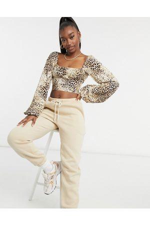 Motel Crop top milkmaid con bustino arricciato color sabbia leopardato