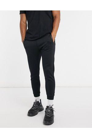 Pull&Bear Joggers neri con tasca e zip